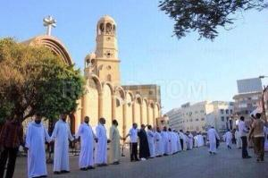 Muslims standing outside a Catholic church in Egypt to protect the worshipers