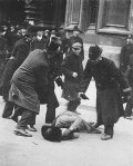 Ada Wright being beaten by police